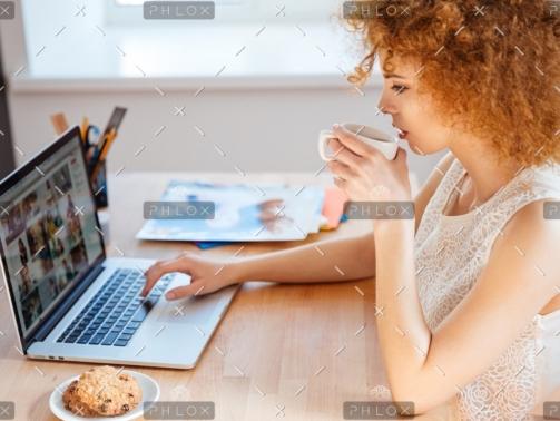 demo-attachment-218-woman-photographer-drinking-coffee-and-working-PJNBP6U@2x